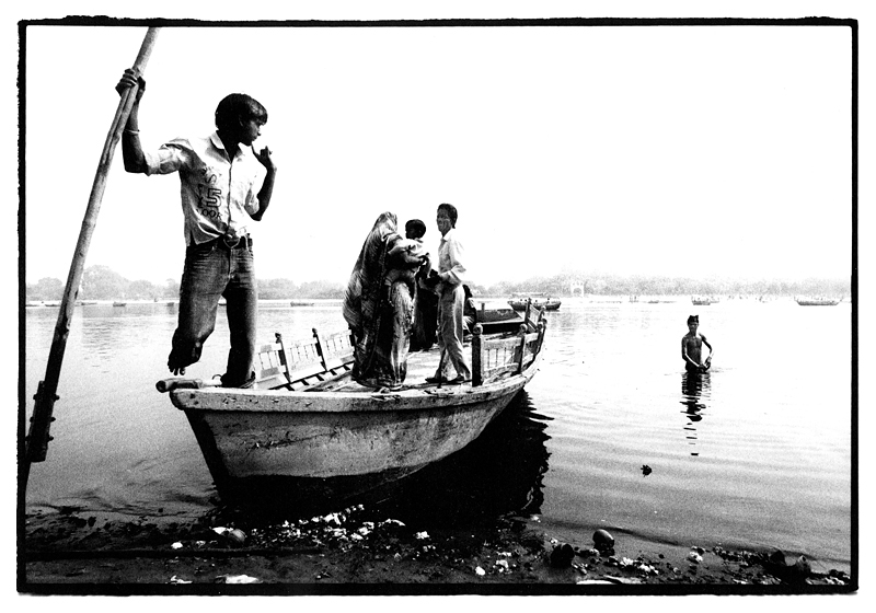 Relaxing, contemplating and meditating in the River Yanumna during Holi festival, India by Toby Deveson. March 2011
