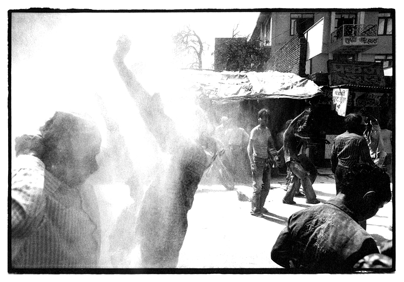 Holi festival parade in Mathura, India by Toby Deveson. March 2011
