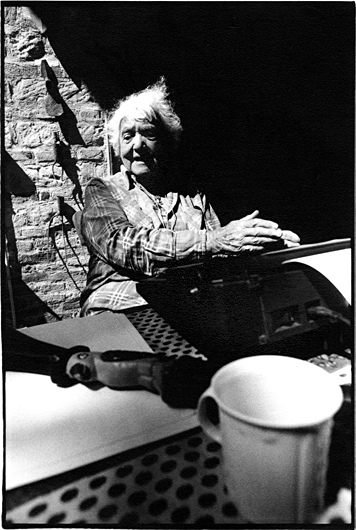 Portrait of Barbara Wace, working at the typewriter, taken in Italy by Toby Deveson. April 1995.